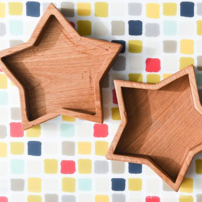 Wooden star bowls made out of alder on a checkered backgrounds