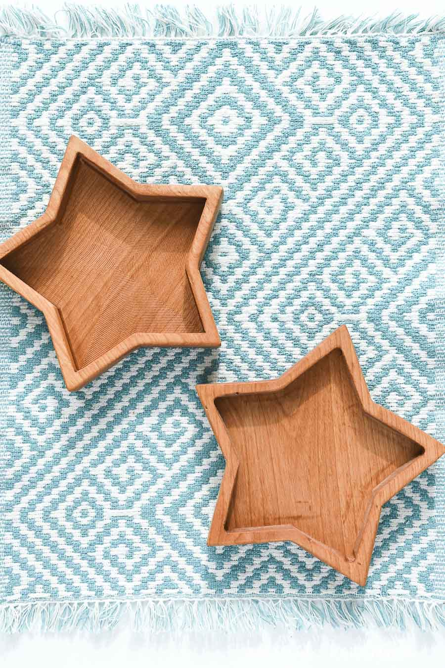 Wooden star boxes on a blue and white placemat