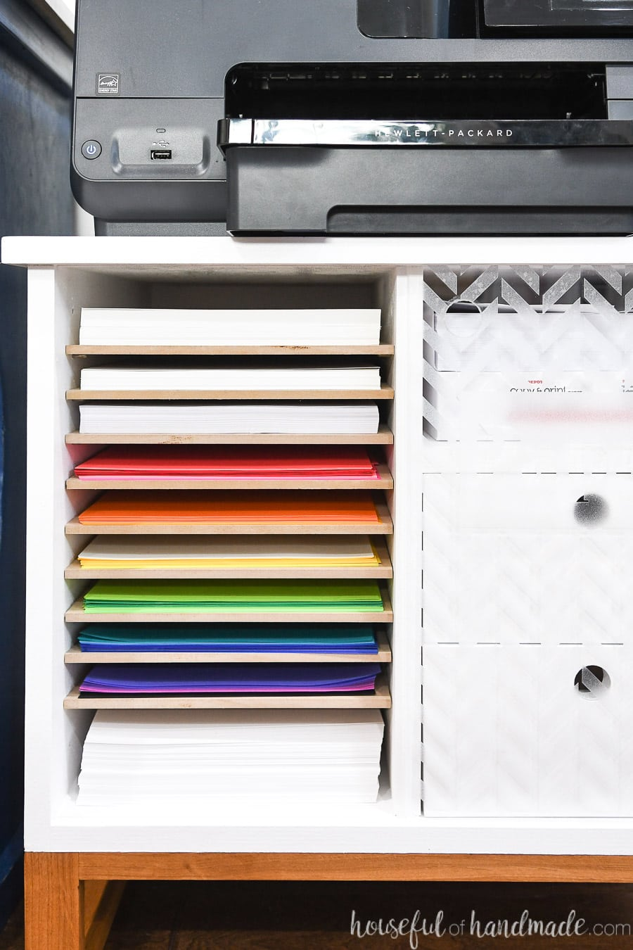 Close up of the paper storage shelves in the printer table.