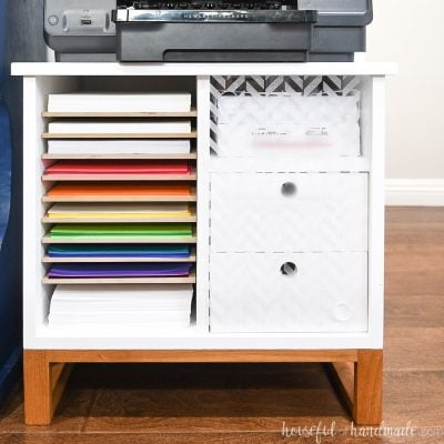 Square photo of the printer stand with paper storage and drawers.