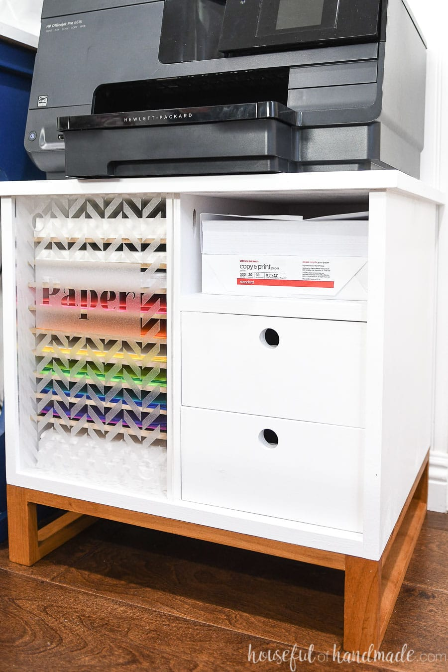 White printer table with printer on top.