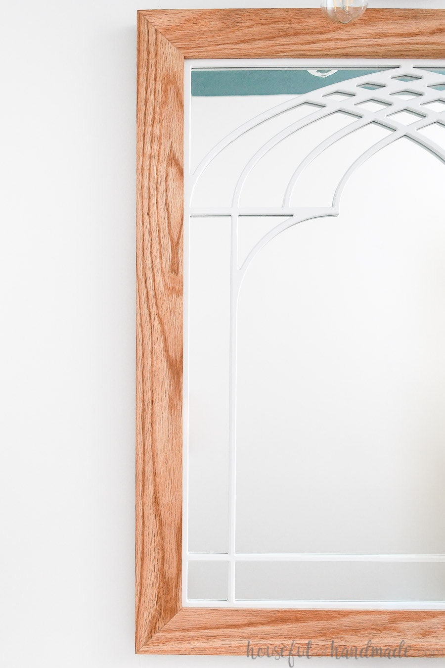 Close up of the window frame mirror with oak frame and white window pane design.