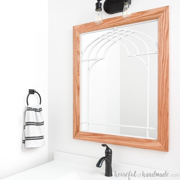 DIY Window frame mirror in bathroom above the vanity.