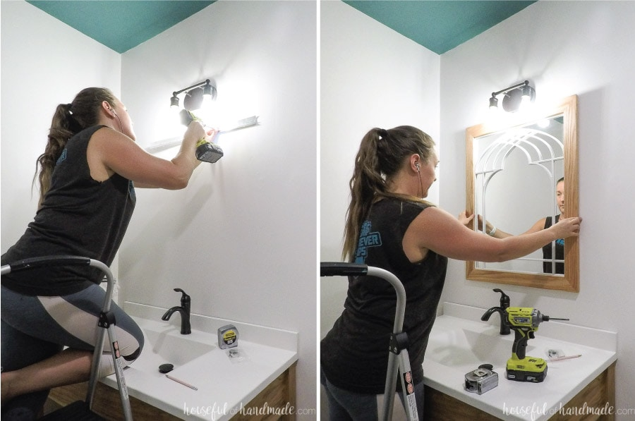 Hanging the DIY mirror that looks like a window in the bathroom.