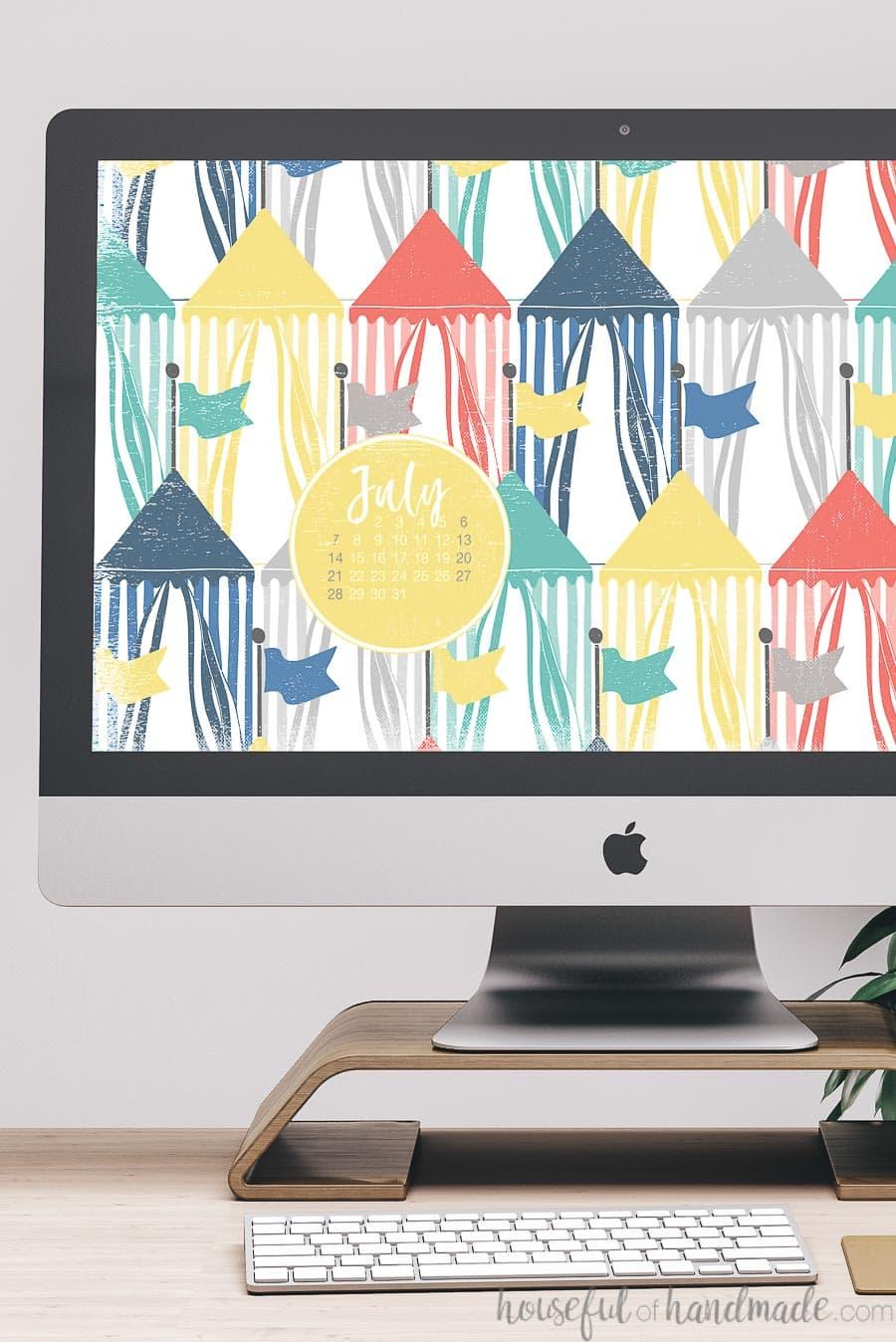 Summer digital wallpaper with calendar on the desktop of a computer.