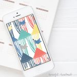 Colorful beach hut digital backgrounds on a smartphone.
