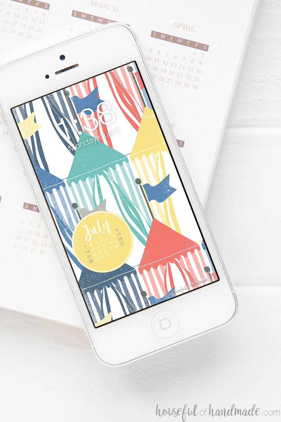 White iPhone with vintage beach hut print digital wallpaper on the screen.