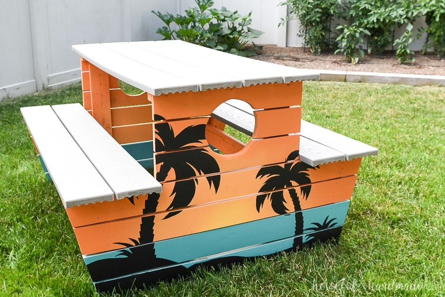 Kids wooden picnic table restored and painted with a tropical design.
