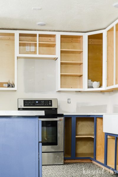 Kitchen remodel with handmade kitchen cabinets on the wall before cabinet doors are installed.