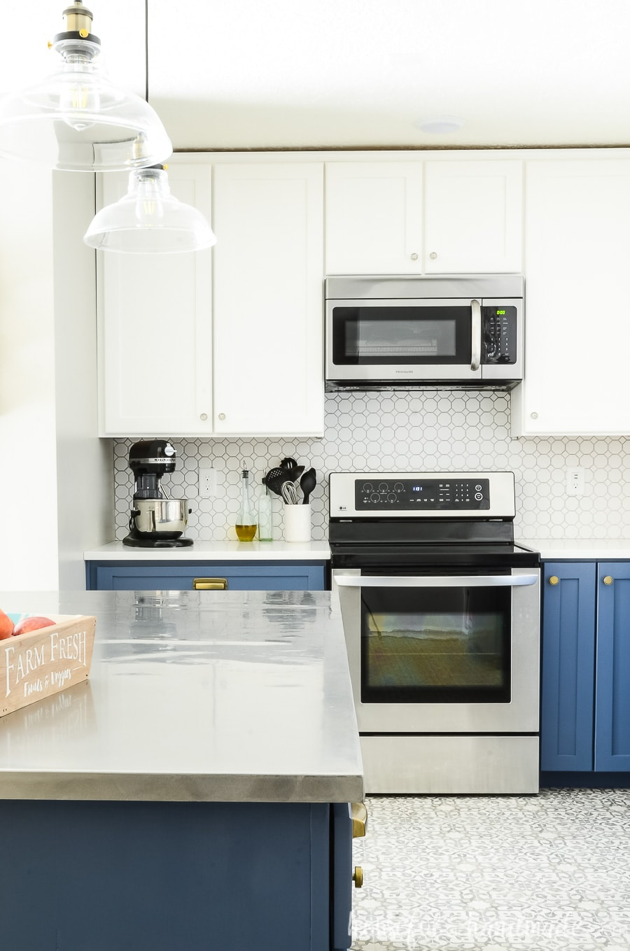 Kitchen remodel with DIY cabinets for the walls in white and blue.