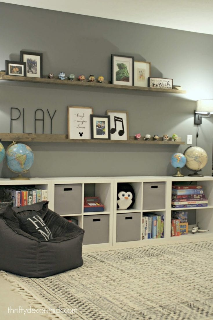 HUGE empty wall transformed into pretty game and toy storage!