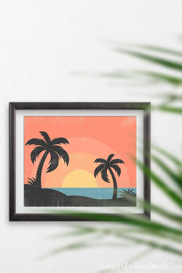 Horizontal tropical sunset art with 2 palm trees looking over the ocean sunset.