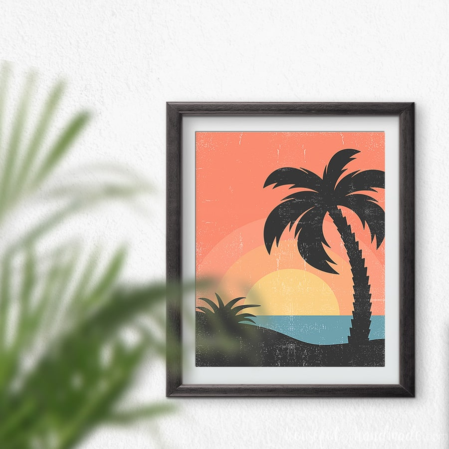 Retro beach art of a sunset with palm trees and bold colors.