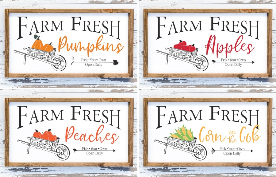 Four fall wood signs: one with pumpkins, one with apples, one with peaches, and one with corn on the cob.