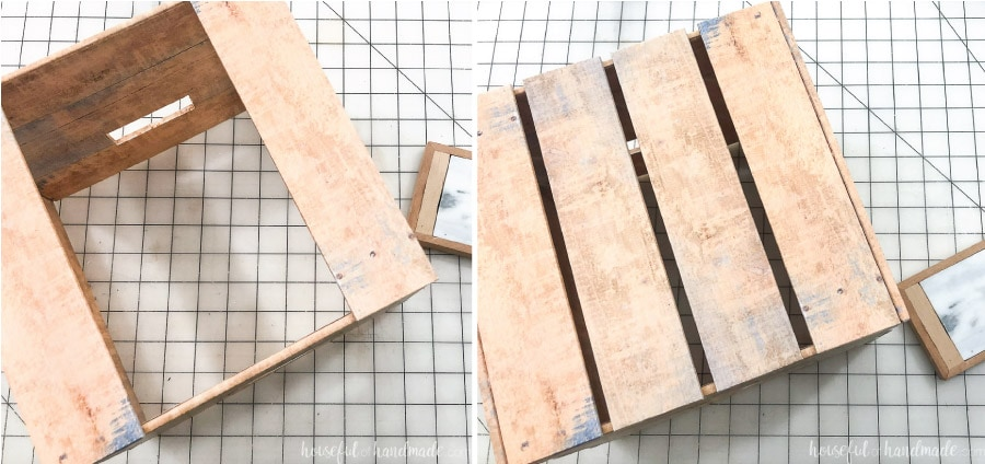 Adding the slats to the front and back of the DIY crate with hot glue.