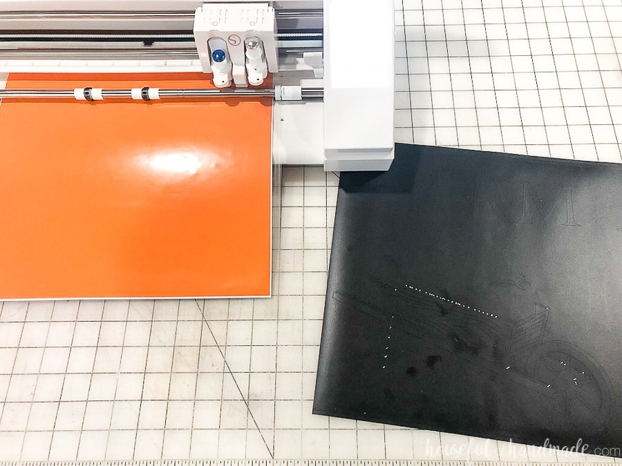 Black vinyl cut out with the pumpkin patch sign design and orange vinyl in the vinyl cutter.
