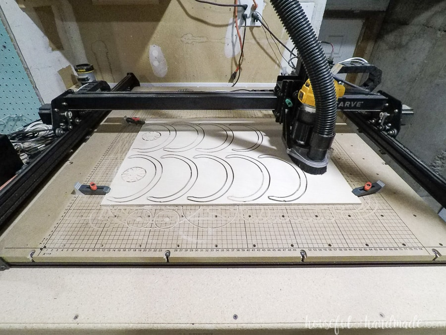 Wood pumpkin pieces being cut out with X-carve CNC machine.
