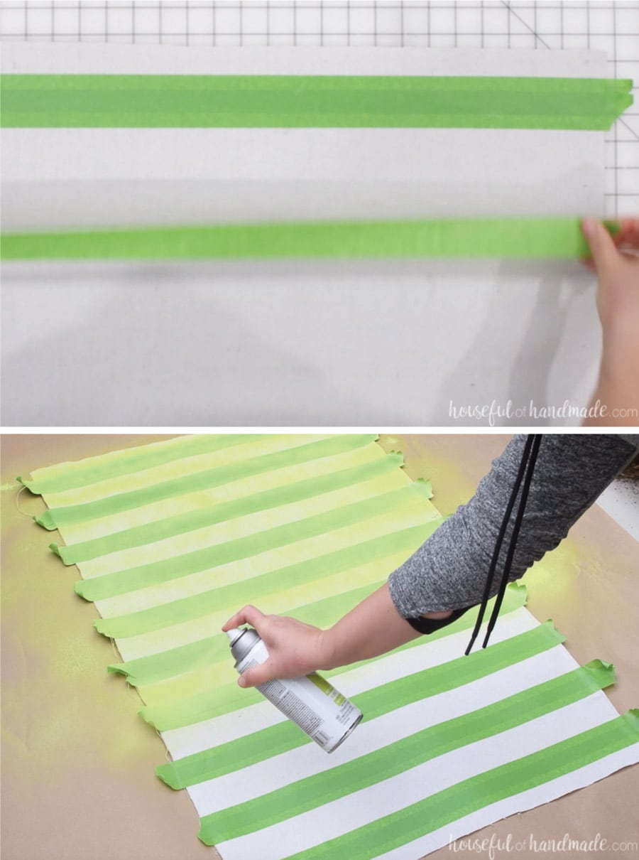 Adding stripes to the drop cloth with painters tape and spray paint.