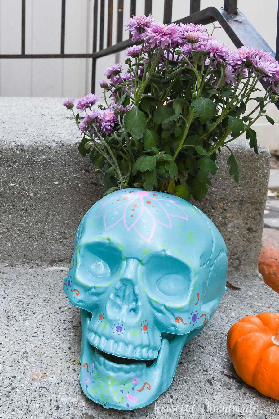 Blue halloween planter on a porch step.