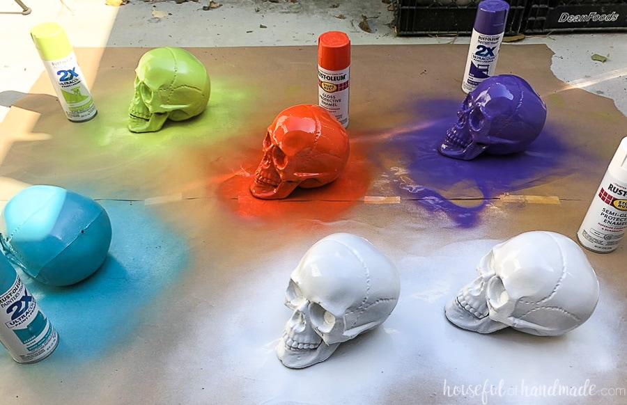 Plastic skulls painted a variety of colors ready to be decorated into sugar skulls.