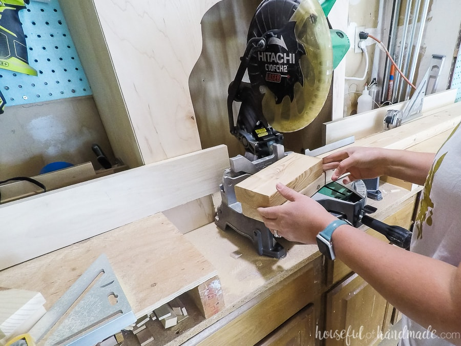 Cutting the pieces of 2x4 to make the scrap wood tables.