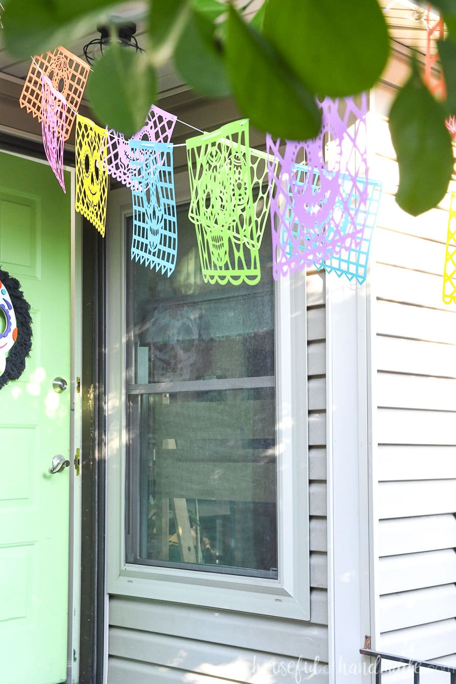 Looking toward the front door seeing the sugar skull paper banners hanging over the porch.