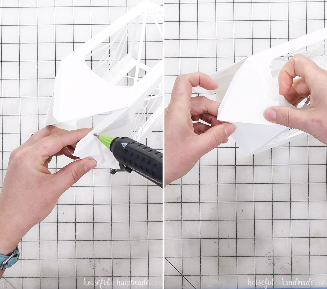 Glueing together the top flaps of the paper halloween lantern.