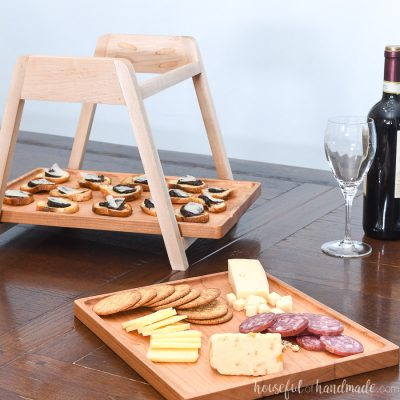 Wood tiered serving on a table with the top tray removed from the serving stand.