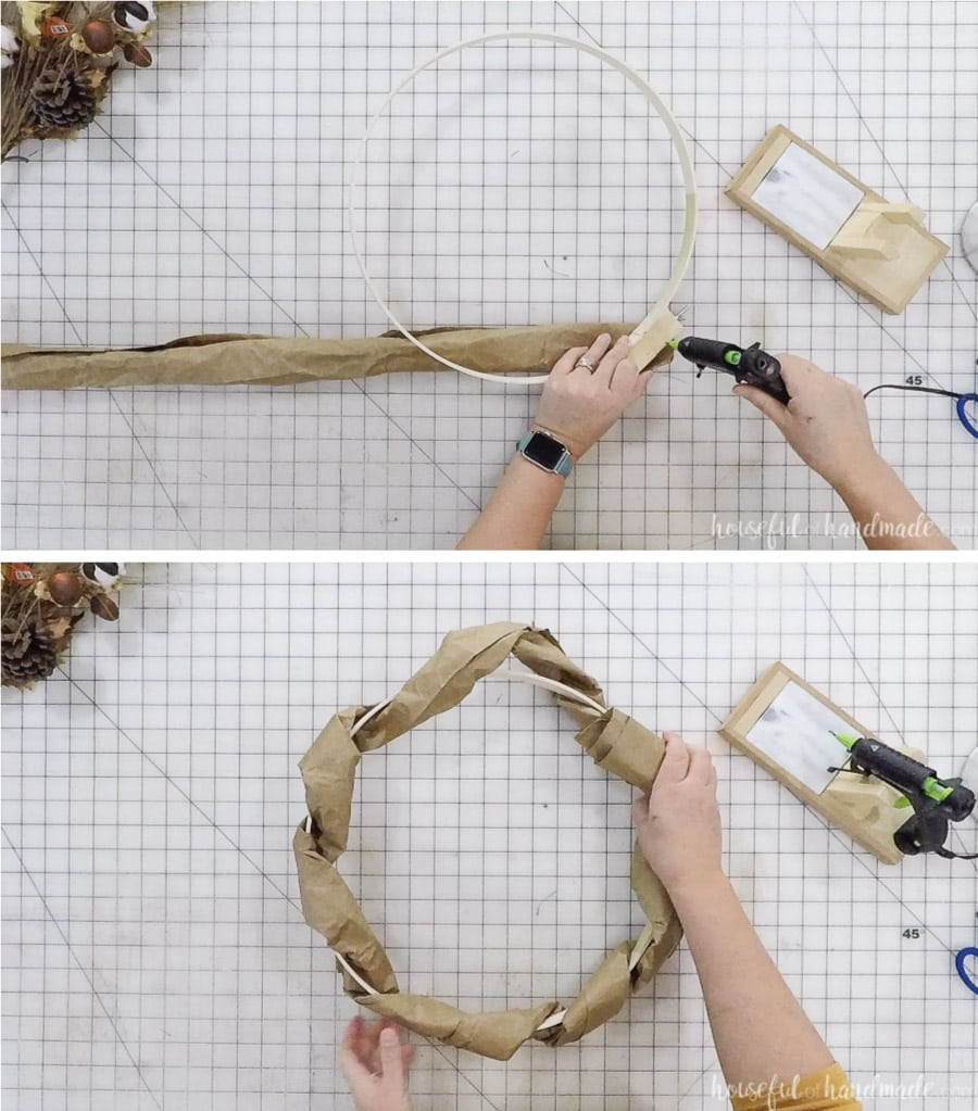 Wrapping the first tube of upcycled paper bag to the embroidery hoop to create the wreath form.