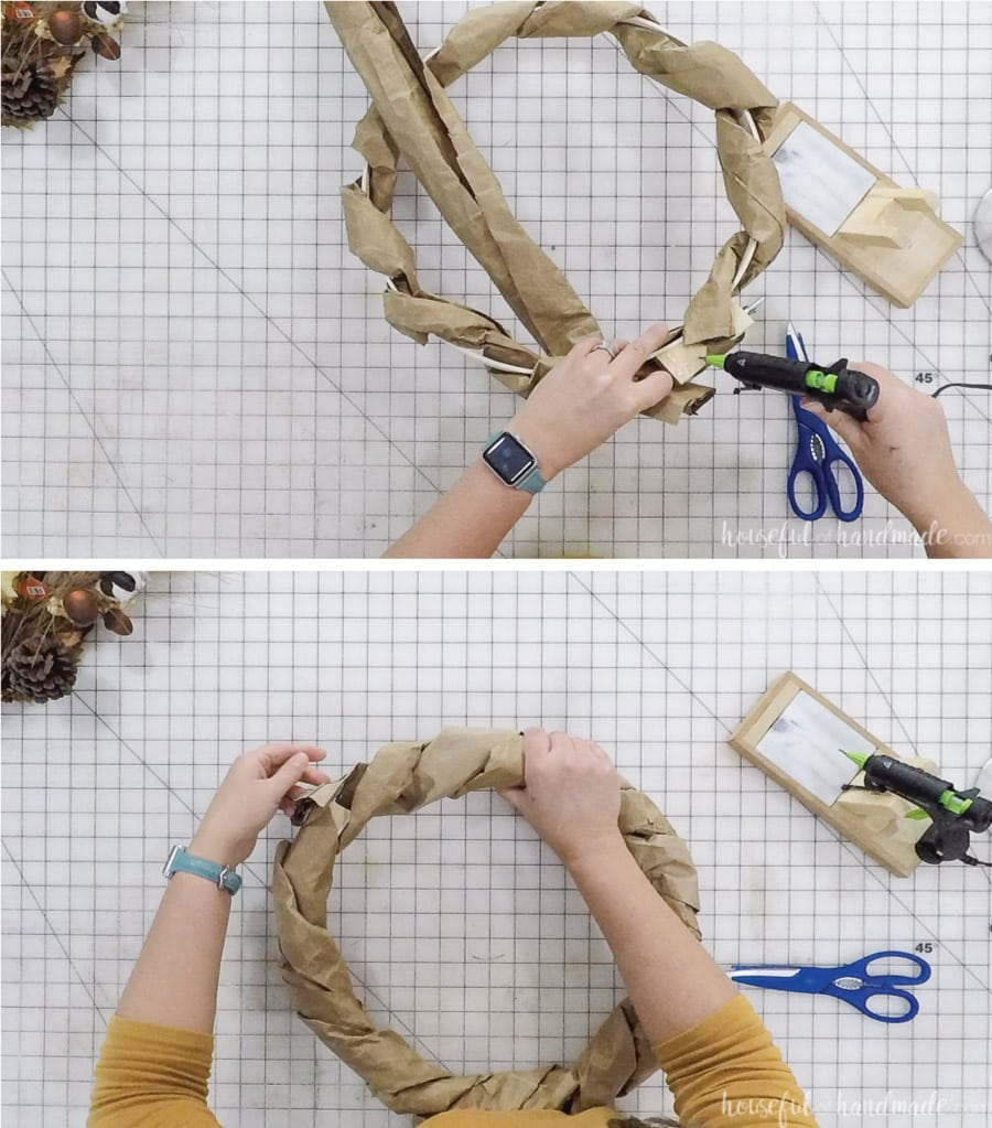 Adding the second tube of brown paper to the wreath.