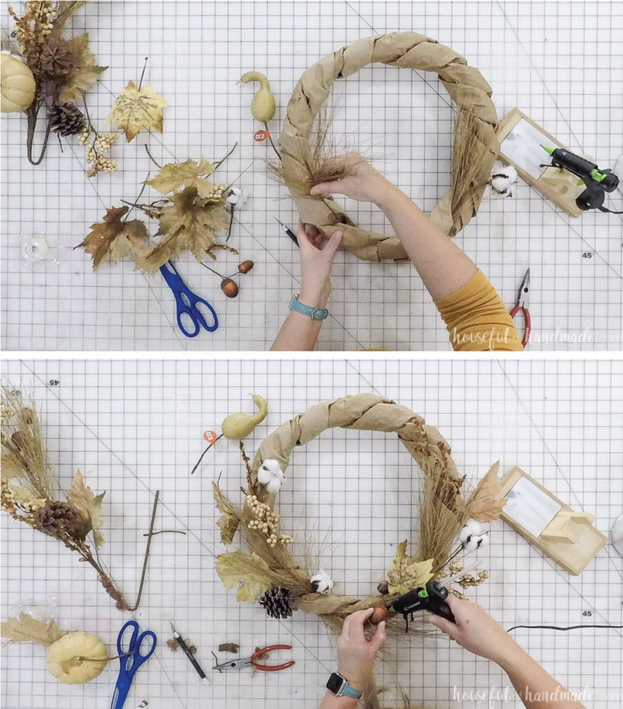 Adding fall floral accents to the paper bag wreath form and glueing too secure.