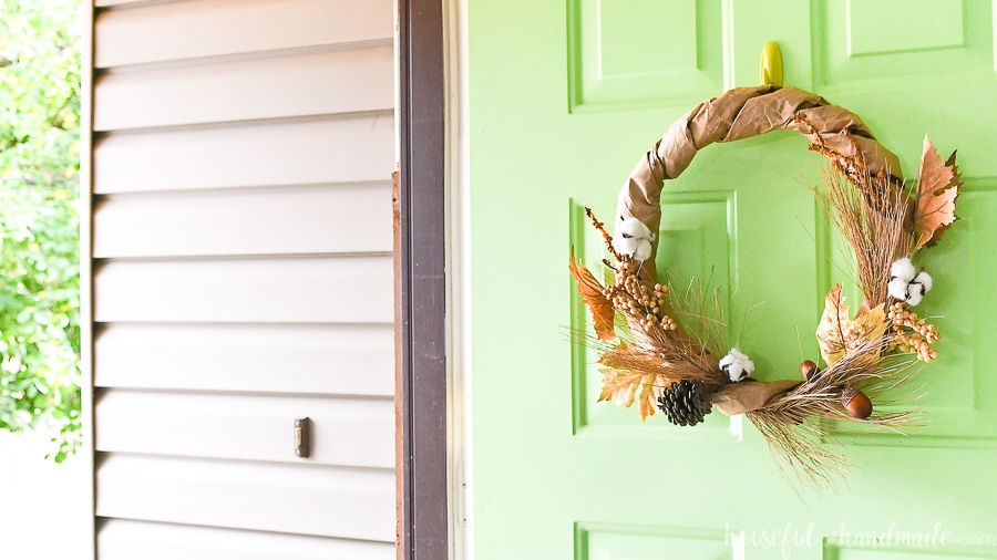 Looking through the open door to the porch with a DIY fall wreath on the door.