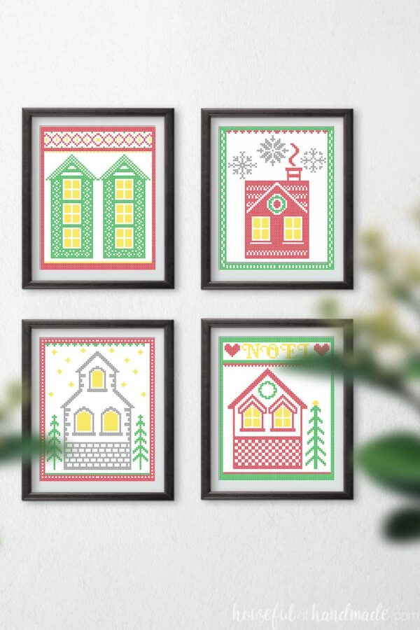 Wall with 4 Christmas printables in frames hanging on it.