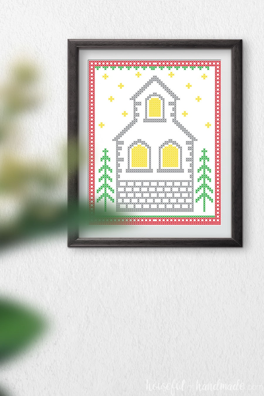 Printable art that looks like a cross-stitched Christmas church.