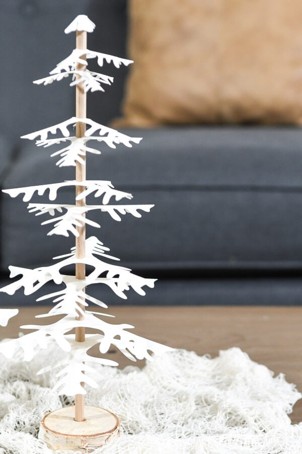Close up photo of the smaller DIY paper Christmas tree siting on a piece of white cloth.