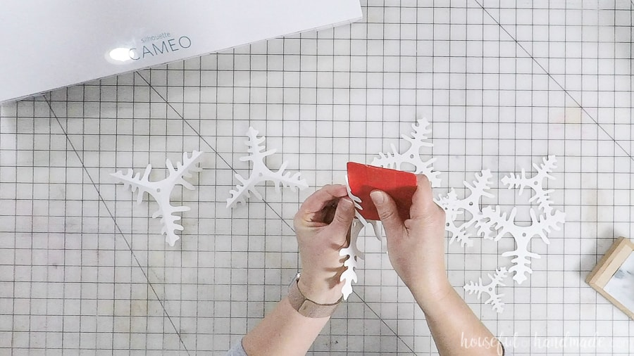 Pinching the cut out branches to give it dimension.