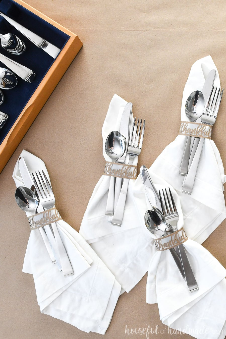 Napkins and silverware in Thankful napkin rings.
