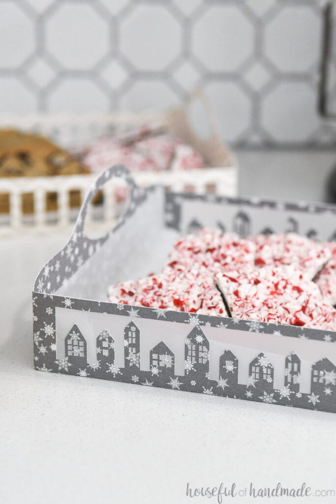 Close-up of the vellum in between the sides of the Christmas village cookie tray.