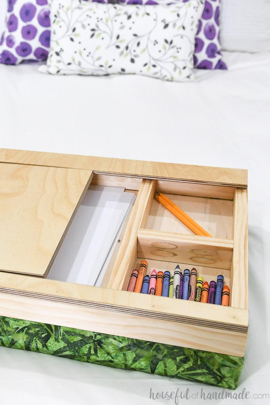 Lap desk with top slide off showing compartments for art supplies underneath.