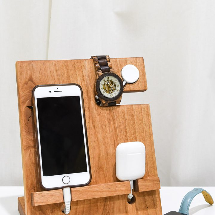 DIY wood valet that holds an iPhone, Apple Watch and AirPods with an Apple Watch charger built in.