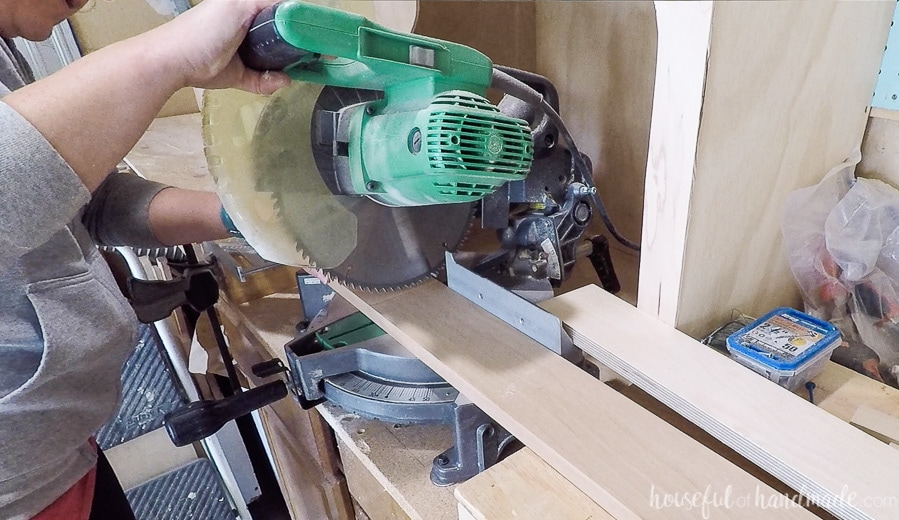 Cutting the board for the front of the charging station with the miter saw.
