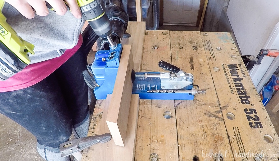 Drilling pocket holes in to the side of a board.