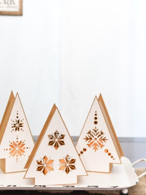 Hygge paper Christmas lanterns in the shape of a Christmas tree on a tray.