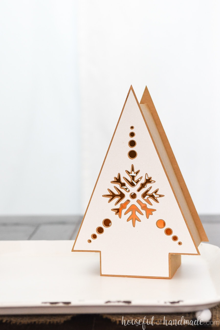 Close up photo of one of the DIY Christmas lanterns with Nordic snowflake design on it.