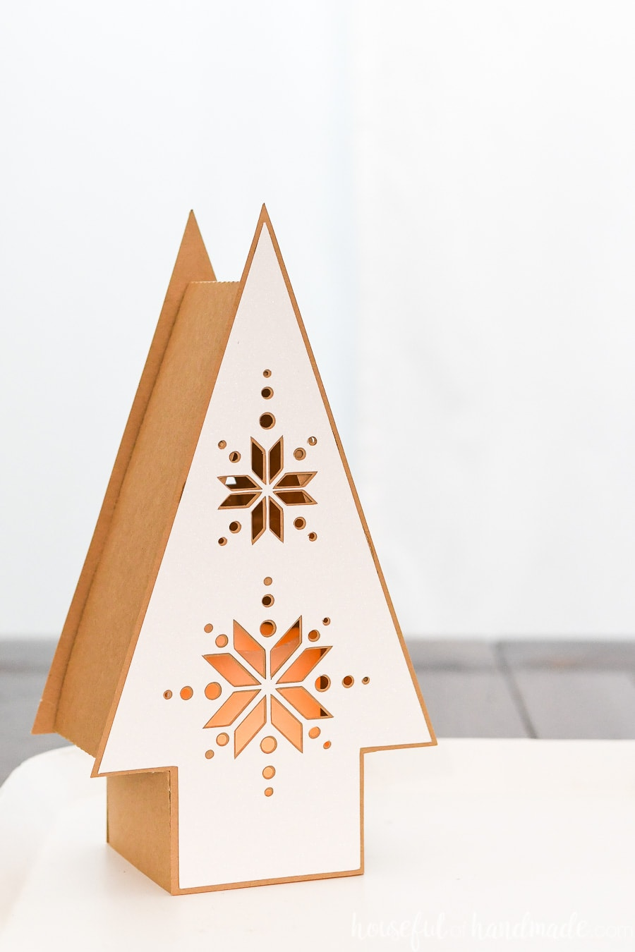 Beautiful Hygge paper Christmas lantern made to look like wood lanterns but made from paper.