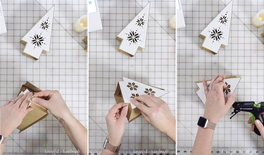 Glueing the back of the paper Christmas lantern onto the sides.