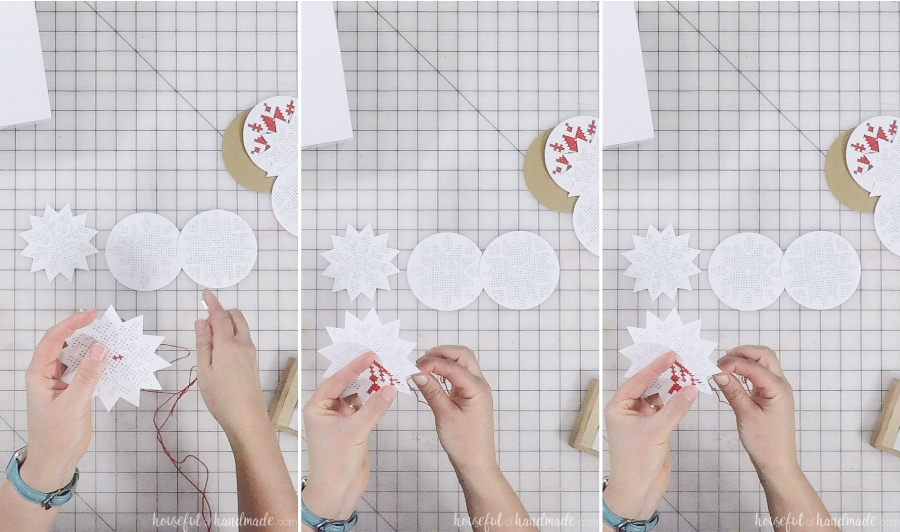 Stitching the cross-stitch snowflake design on the paper ornaments.