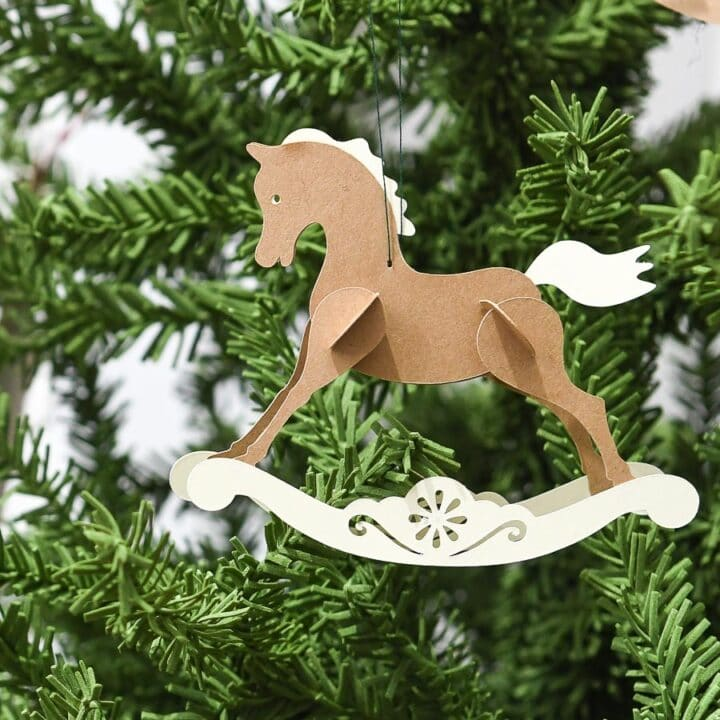 Close up photo of the paper rocking horse Christmas ornament.