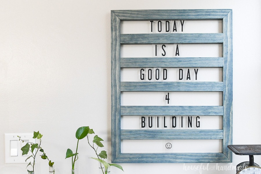 Horizontal photo showing the DIY sliding letter board with a fun saying in it.