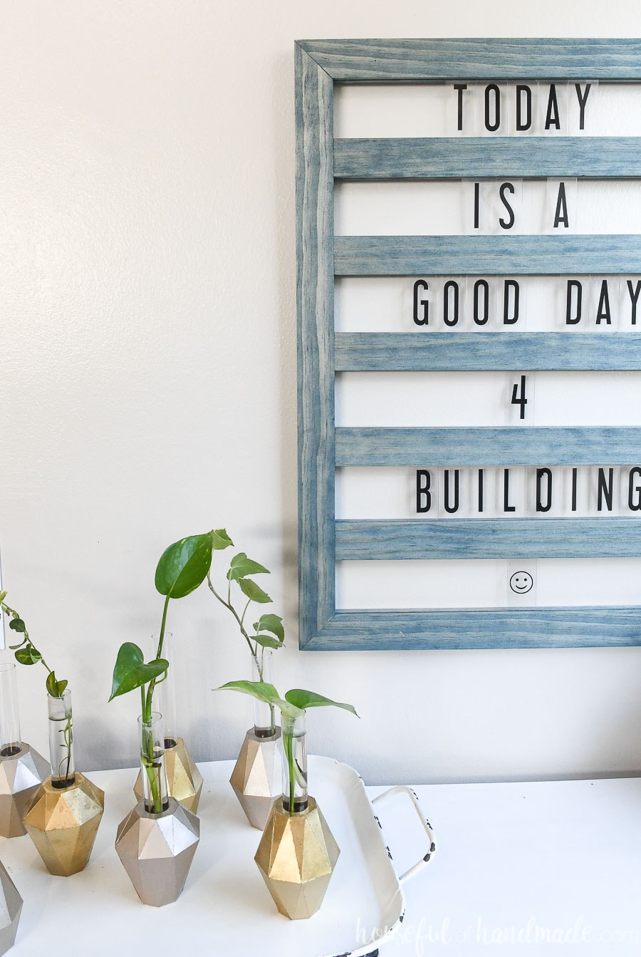 "Close up of the sliding letter board with the words ""Today is a good day 4 building"" showing on it."